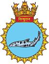 Submarine crest with a large, spotted fish