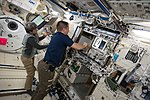 ISS-52 Peggy Whitson and Jack Fischer work on station systems in the Kibo lab.jpg