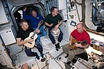 ISS-55 Crew members during an out of this world jam session.jpg