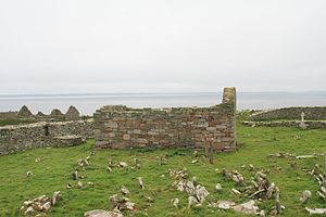 Inishmurray - Teampall Molaise, the principal church of the monastery, as seen from the north with the mainland in the background.