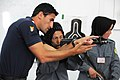 Italian Carabinieri shows a female Afghan National Police recruit how to aim an AMD-65 at the Central Training Center in Kabul.jpg