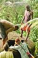 Jake Ward, water and sanitation volunteer at ADRA checks a water tank near a village in Makira. (10705653706).jpg