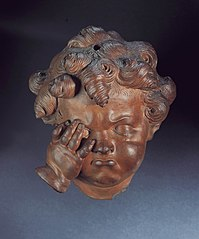 Head of a weeping child, with the right hand on the cheek