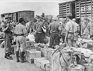 Thailand in World War II - A British officer of a Gurkha regiment supervises Japanese prisoners at Bangkok railway station September 1945