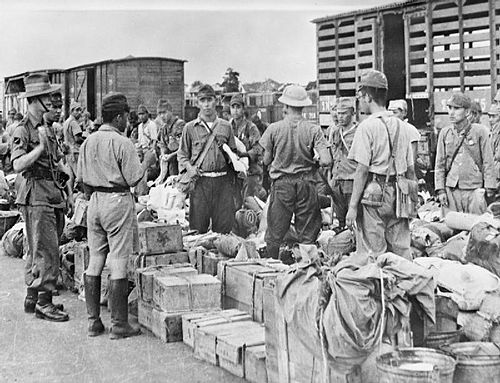 A British officer of a Gurkha regiment supervises Japanese prisoners at Bangkok railway station September 1945 Japanese Troops Leave Bangkok, 1945 IND4836.jpg