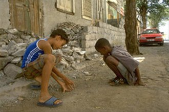 Demographics of Cape Verde - Two Cape Verdean children playing marbles