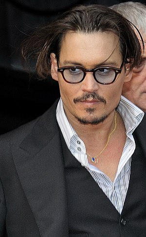 Johnny Depp during the Paris premiere of Publi...