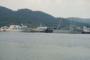 Lumut, Malaysia - Royal Malaysian Navy training ship KD Hang Tuah (left) and multi-role support ship KD Mahawangsa seen berthed at Lumut Naval Base