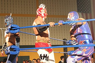 Drago (wrestler) - Drago (left) with Fénix and Aero Star at Chikara's King of Trios in 2015.