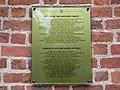 Kościół p.w NMP Królowej Pokoju - tablica na murze Kościoła - panoramio.jpg