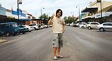Korean bloke standing on main street of Bourke.jpg