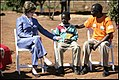 Laura Bush talks with Zambian boy.jpg