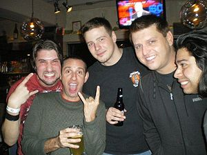 Less Than Jake - Buddy (second from left) and Chris (second from right) of Less Than Jake posing with fans in Asbury Park (November 2009).