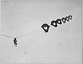 Lieutenant Kirk Booth of the U.S. Signal Corps being lifted skyward by the giant Perkins man-carrying kite at Camp Devens, Ayer, Massachusetts.jpg