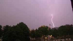 File:Lightnings and rainbow.webm