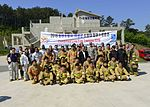 Live fire training partners Airmen with local firefighters 160518-F-AM292-020.jpg