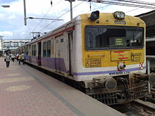 White-and-yellow electric train at a station