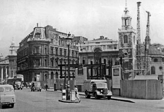 Queen Victoria Street, London - Queen Victoria Street's eastern end pictured in 1955. The church of St Stephen Walbrook (right) is undergoing repair after damage in the Blitz. The Bank of New Zealand's building at 1 Queen Victoria Street is centre left