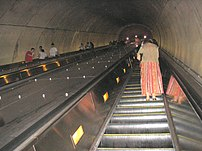 A very long escalator in the Washington Metro. This is the main escalator going from the platform to tickets/fare at the Bethesda Station in Bethesda, Maryland.