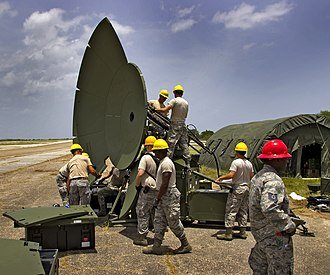 236th Combat Communications Squadron - 236th Combat Communications Squadron members assemble a Ground Multi-Band Terminal in Aguadilla, Puerto Rico during a training exercise