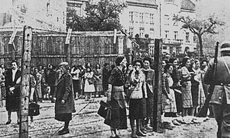 Racial segregation - Women behind the barbed wire fence of the Lvov Ghetto in occupied Poland. Spring 1942