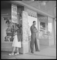 Madera County, California. Hanging Around. Waiting for the movie house to open at 1 p.m. Sunday in the small San... - NARA - 532151.tif