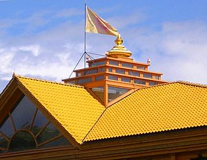 Maharishi Vastu Architecture - A kalash atop a Brahmasthan, with the flag of the Global Country of World Peace, on the Maharishi's HQ in Vlodrop.