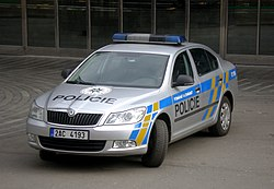 Newer-model police car, gray with blue-and-yellow markings