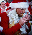 Man dressed as Santa Claus smoking a cigarette.jpg