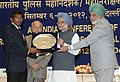 Manmohan Singh honours Shri Yogeshwar Dutt, the London Olympic Bronze Medal winner, at the All India Conference of Directors GeneralInspectors General of Police -2012, in New Delhi. The Union Home Minister.jpg