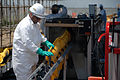 Mechanized boom decontamination deepwater horizon.jpg