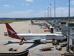 Melbourne Airport T1 with Qantas and Jetstar jets.jpg