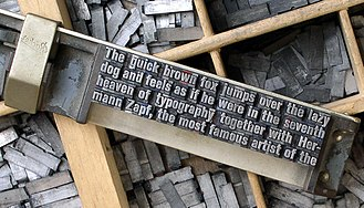The quick brown fox jumps over the lazy dog - The phrase shown in metal moveable type, used in printing presses (image reversed for readability)