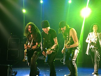 "Dean Guitars - Dean artists Michael Schenker and Wayne Findlay with Dean owner Elliott ""Dean"" Rubinson"