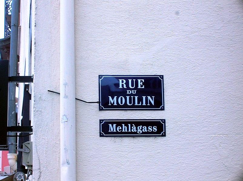 Milhüüse (Mulhouse): zweisprochi Strossaplàkàt (elsassisch, frànzesch): els: Mehlàgass, fr: Rue du Moulin