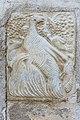 Millstatt Pfarrkirche Christus Salvator West-Wand rom Relief Vogel mit 3 Jungen 20042015 2269.jpg