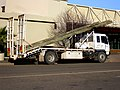 Mitsubishi Fuso FM557 carrying utility poles (1).jpg