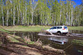 Mitsubishi Pajero Sport runs through spring puddle 02.JPG