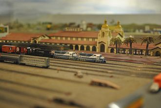 San Diego Model Railroad Museum - A model of the San Diego Union Station at the San Diego Model Railroad Museum along with a number of model trains.
