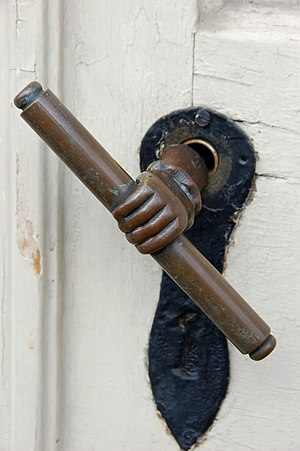 Ornate door handle on a Moravian Church.