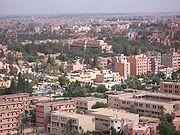 يا بنات ادخلوا لاعرفكم على مدينتي مراكش الحمراء 180px-MoroccoMarrakech_townfromhill