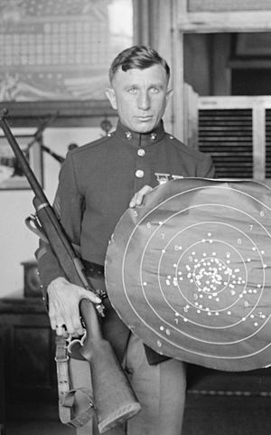 Morris Fisher - Morris Fisher in 1923 holding his 300 m rifle and its target