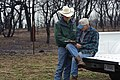 NRCS District Conservationist Tony Dean (right) discuss ranch management options with a Jack County landowner after a wildfire burned through the area three weeks earlier. (24816030410).jpg
