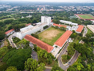 Bukit Timah - NUS Bukit Timah Law Faculty Campus from the air. 2015. The Singapore Botanic Gardens sits to the left of the school.