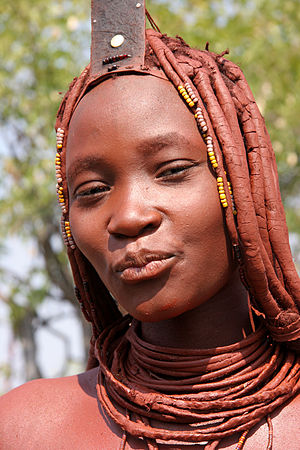 Female cosmetic coalitions - A Himba woman (northern Namibia) cosmetically adorned with red ochre.