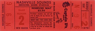 A red rectangular ticket with game and seating information