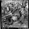 Navy personnel on liberty at Mogmog Island. Enlisted men lounge about a tiny island with plenty of beer. - NARA - 520730.jpg