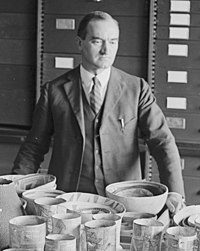 Neil M. Judd of Natl. Geographic Society with Indian Pottery, 11-20-1924 (cropped).jpg