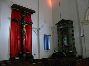 Sacred Heart Cathedral, New Delhi - Side chapel with cross and statue of the Virgin