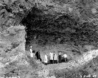 Marmes Rockshelter - Unknown officials in the Marmes Rock Shelter before it was submerged.